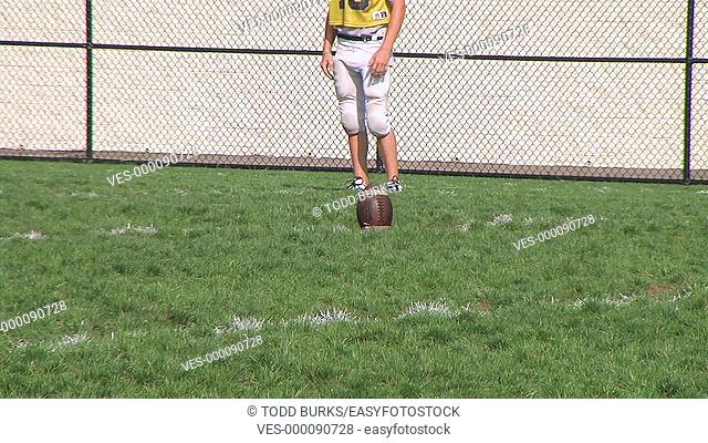 Kicker performs onside kick during practice