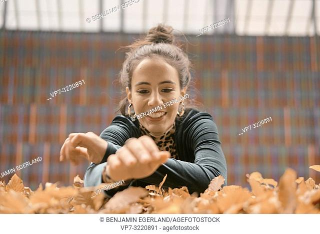 woman, autumn leaves