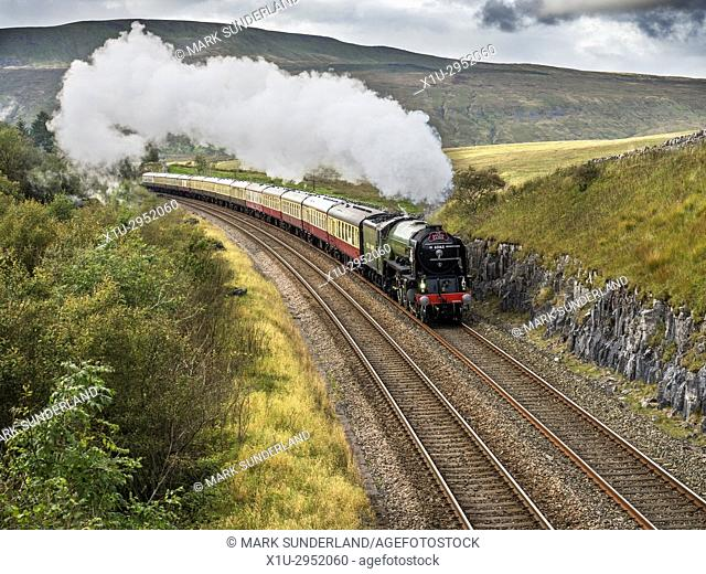 Tornado Steam Locomotive Hauling the Border Raider after departure from Ribblehead Station Yorkshire Dales England