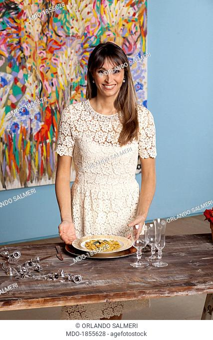 The TV presenter Benedetta Parodi posing for the photo shooting dedicated to the great chefs. On the table, the dish she proposed for Christmas