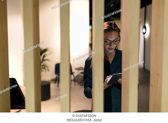 Businesswoman using tablet in modern office