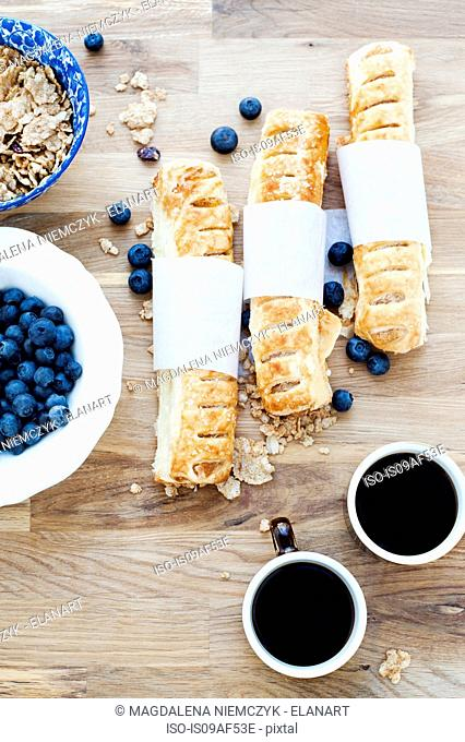 Baked pastries, blueberries and black coffee