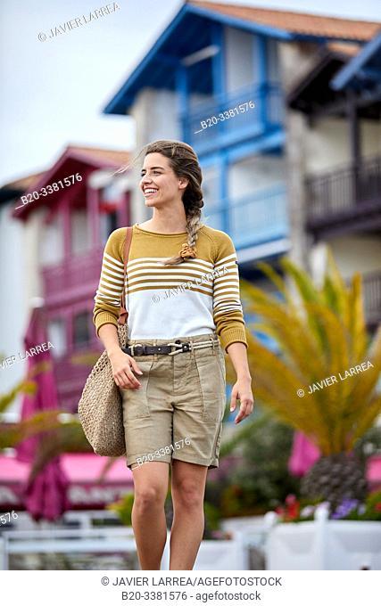 Woman walking near the harbour, Sokoburu, Hendaye, Aquitaine, Basque Country, France
