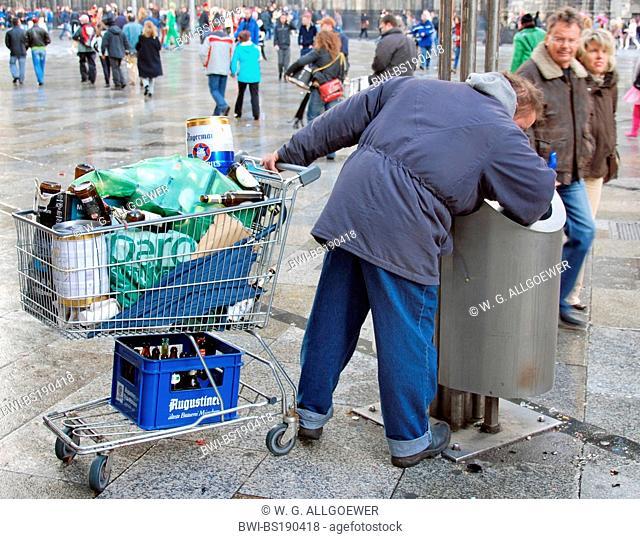 man looking for deposit bottles, Germany