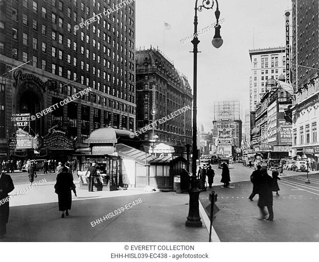 Times Square and Broadway, New York City, ca. 1933. At left, the Paramount Theater marquee promotes the movie PICK-UP with George Raft and Sylvia Sidney