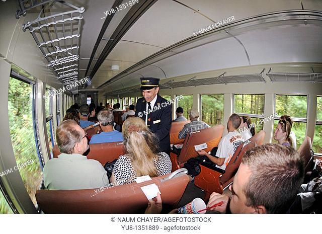 Conductor checking tickets, Lehigh Gorge Scenic Railway, Jim Thorpe, Pennsylvania, USA