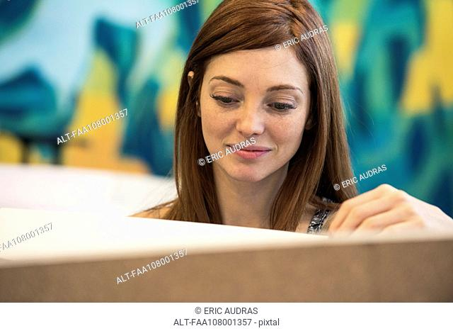 Woman smiling while working