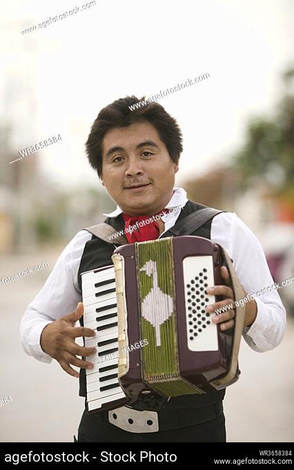 Portrait of man playing accordion