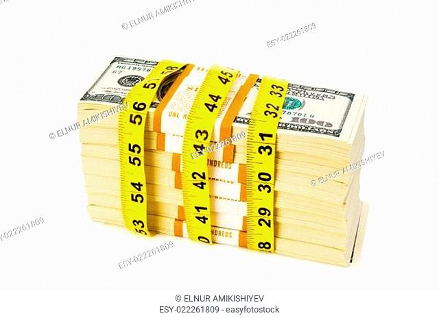 Financial concept - measuring money isolated on white