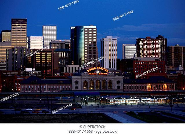 Denver skyline and Union Station at dusk from Riverfront Park