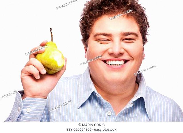 Chubby boy and pear