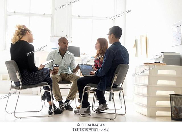 Friends having business meeting in office
