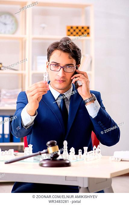 Young lawyer playing chess to train his court strategy and tactics