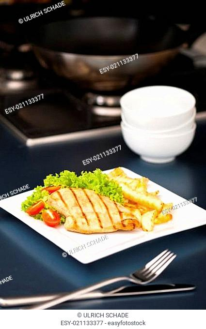 Chicken, French fries and salad