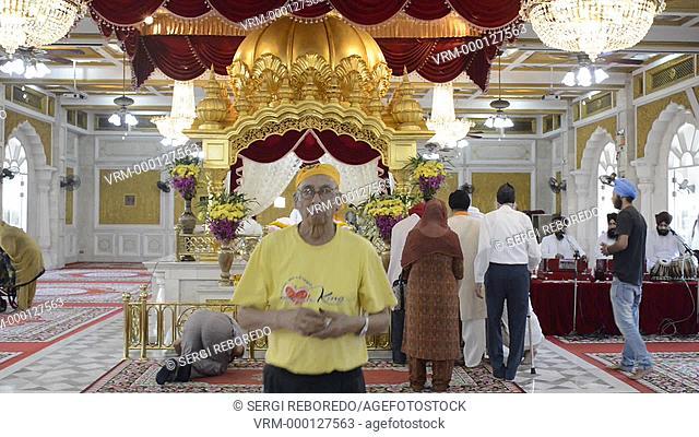 A man prays in the Darbar Sahib (prayer hall) at Gurdwara Siri Guru Singh Sabha, the Sikh temple in Bangkok