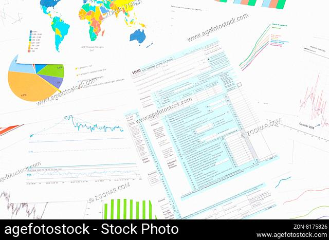 1040 US Tax Form with financial graphs