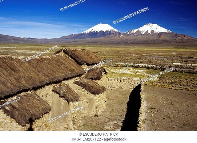 Bolivia, Oruro department, Sajama province, Sajama National Park, Sajama, Pomerape and Parinacota volcanoes seen from the colonial church 16th century