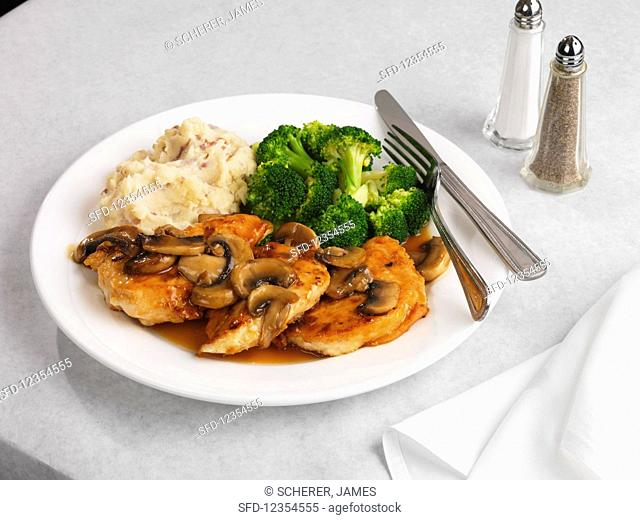 Sliced chicken in Marsala sauce with broccoli and mashed potatoes