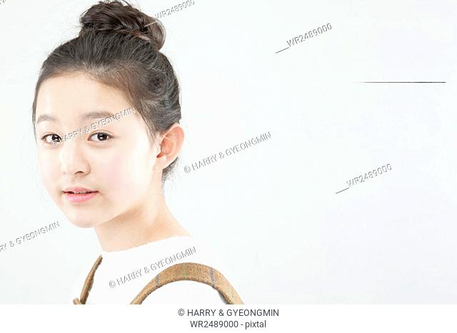 Side view portrait of smiling Korean school girl