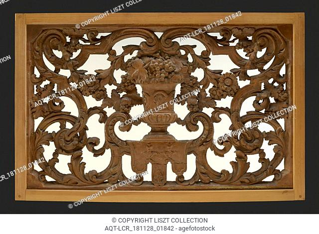 Skylight with an antique vase of wood carved in wood, surrounded by leaves, flowers and garlands, cutting window toplight carvings sculpture footage wood paint
