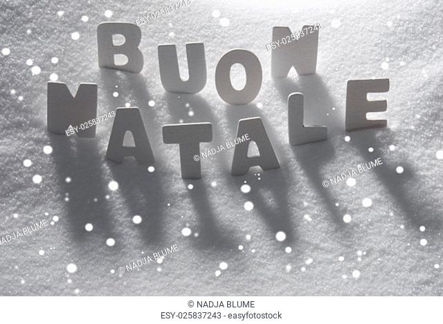 White Letters Building Italian Text Buon Natale Means Merry Christmas On White Snow. Snowy Landscape Or Scenery With Snowflakes