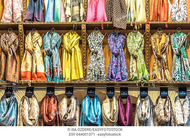 Traditional colorful silk ,cashmere head scarves or shawls and fabrics composed of a stack background at the bazaar stall in Istanbul, Turkey