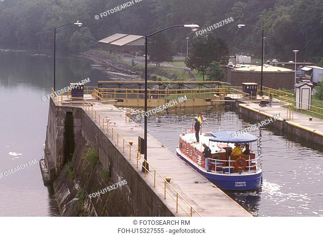 New York, Seneca Falls, Finger Lakes, Cayuga-Seneca Canal. A red, white and blue cruise line boat in double lock, 49 feet drop