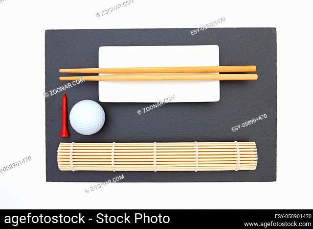 Rectangular slate plate with chopsticks for sushi and golf ball. Golf Design
