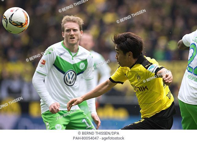 Dortmund's Shinji Kagawa (R)in action against Wolfsburg's Andre Schuerrle during the German Bundesliga soccer match between Borussia Dortmund and VfL Wolfsburg...