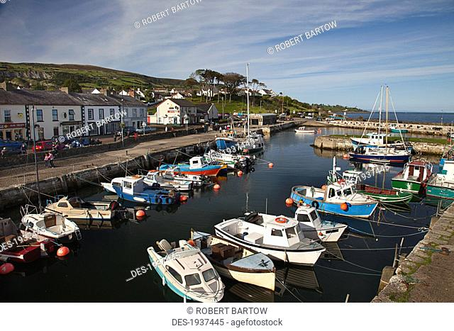 boats in carnlough harbor, county antrim ireland