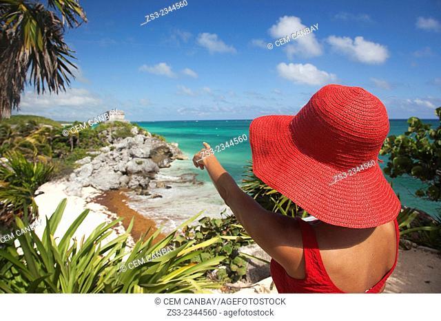 Woman posing at Tulum Ruins, Quintana Roo, Yucatan Province, Mexico, Central America