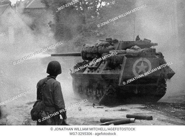FRANCE St Lo -- Jun 1944 -- A US Army M10 tank destroyer in action against German panzers at St Lo in Normandy, France, during the Battle of Normandy in June...