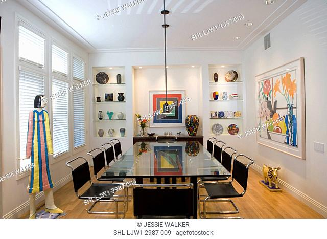DINING ROOM: Contemporay formal dining room, art collections of pottery and glass, 20thc prints, sculpture, glass toppedtable with leather chairs