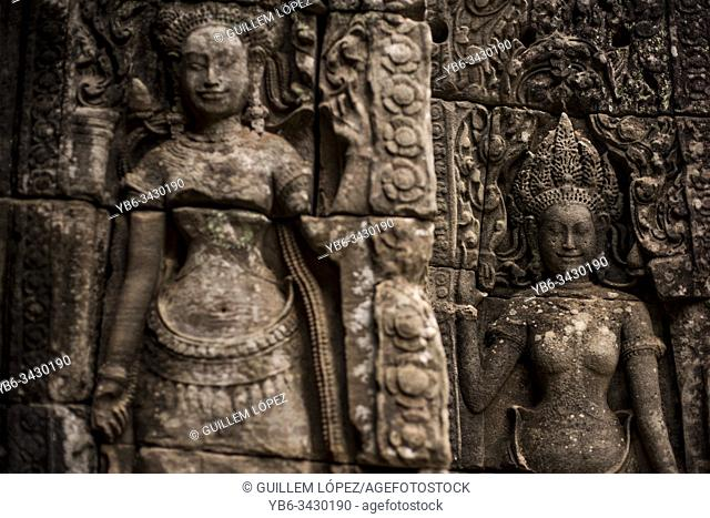 Stone carved goddess at the walls of Bayon in Angkor Thom temple, Angkor Wat, Cambodia