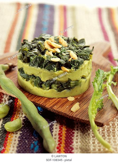 Small savoury cake with with broad beans and turnip tops