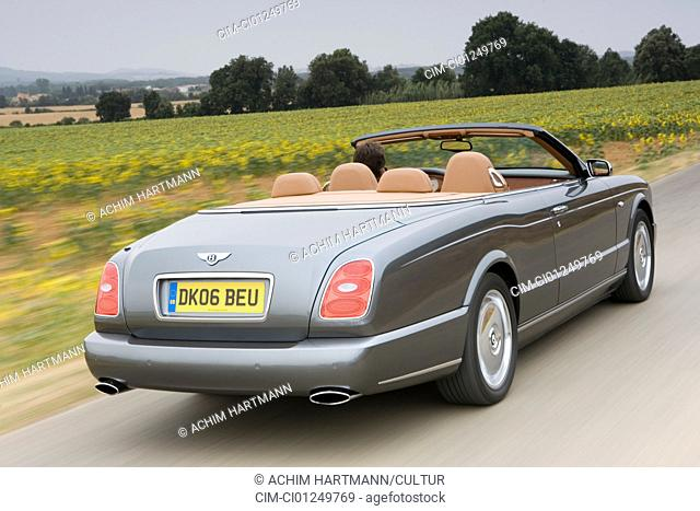 Bentley Azure, model year 2006-, anthracite, driving, diagonal from the back, rear view, country road, open top