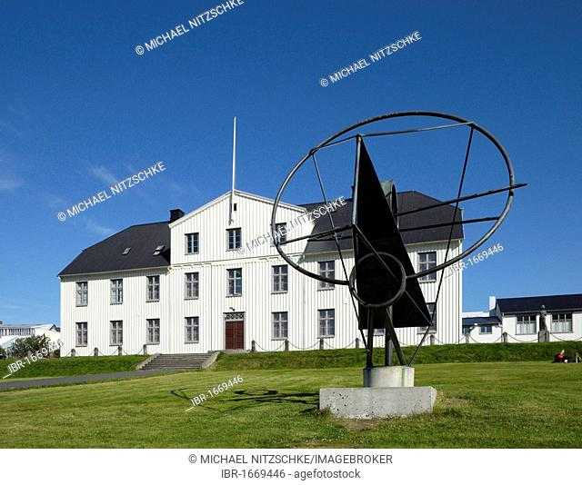 Old grammar school building with sculpture the face of the sun, Reykjavik, Iceland, Europe