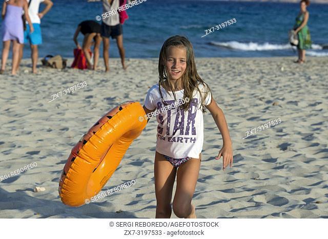 Sa Roqueta Beach and Ses Illetes Beach, Balearic Islands, Formentera, Spain. Funy girl with floats