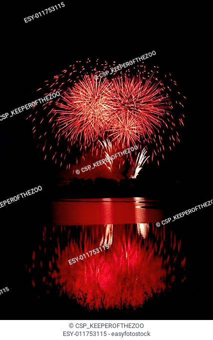 Red Fireworks Reflected on Water