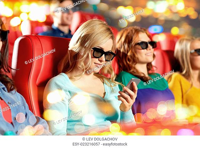 cinema, technology, entertainment and people concept - happy woman with 3d glasses and smartphone reading message in movie theater