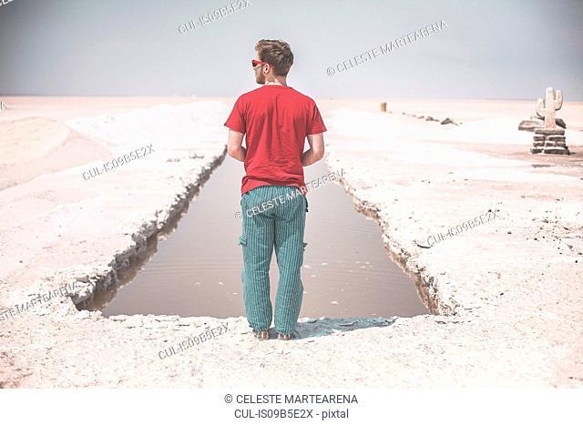 Man exploring salt flats, Salinas Grandes, Iruya, Salta Province, Argentina