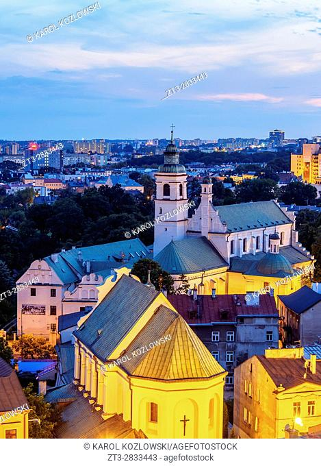 Poland, Lublin Voivodeship, City of Lublin, Old Town, Elevated view of the churches of Peter the Apostle and the Conversion of St Paul at twilight