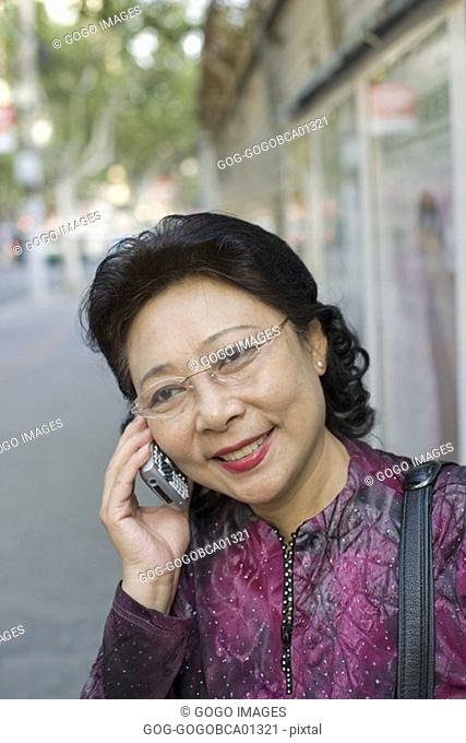 Middle-aged woman talking on her cell phone