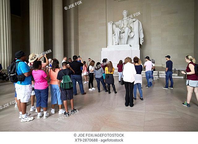 tourists inside the lincoln memorial Washington DC USA