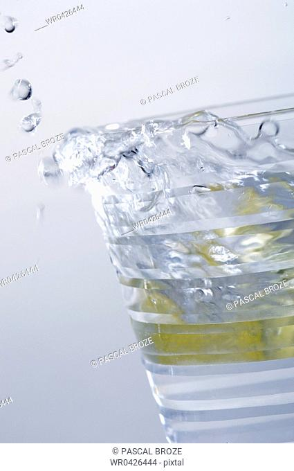Close-up of a glass of water with a lemon slice