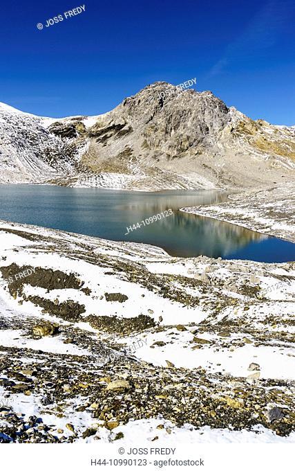 The mountain lake Lajet da Lischana near the valley Val S-charl, Lower Engadine, Switzerland. In the background the mountain Piz da l'Aua