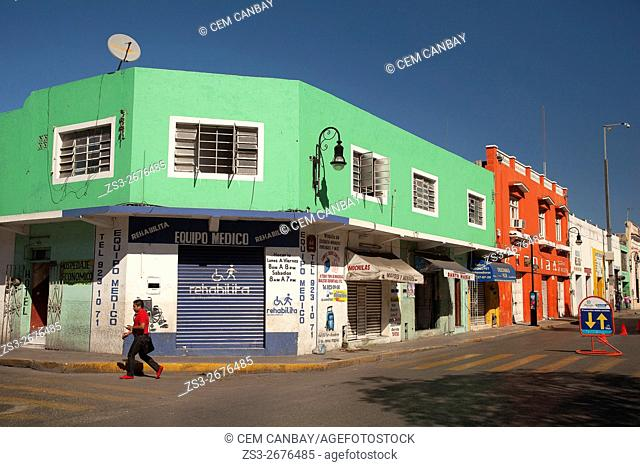 Man walking in front of the colorful colonial buildings in city center, Merida, Yucatan Province, Mexico, Central America