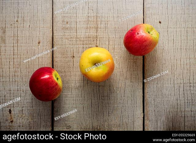 Apple lined up on the old wooden floor