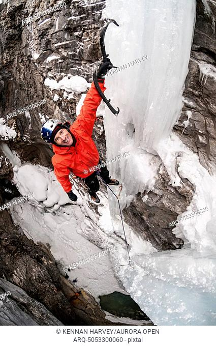 A man ice climbing in Marble Canyon, Kootenay National Park, British Columbia, Canada