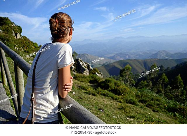 Young woman enjoying the views from El Fitu Viewpoint (Mirador del Fitu), Asturias